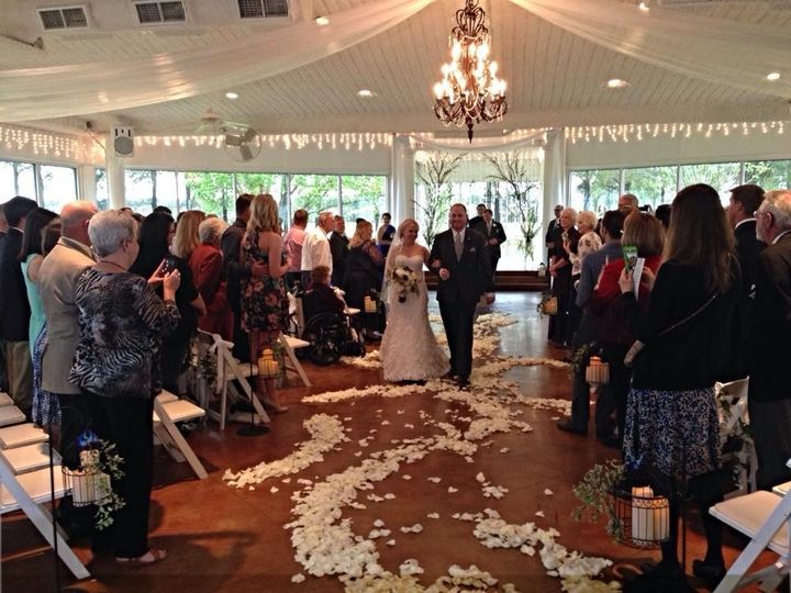 bride and groom at house plantation and rose petal