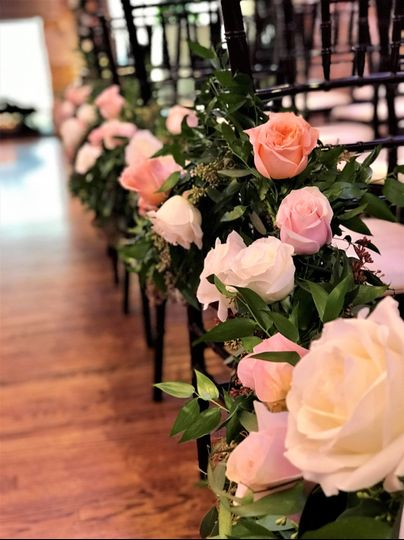 Rose and garland aisle decor