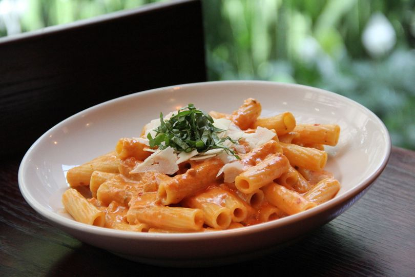 Fresh rigatoni pasta tossed in a homemade vodka sauce topped with basil and shaved Parmesan.