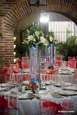 Reception room decorations with tall vase centerpiece strung with Crystals
