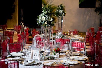 Reception decorations with chavarri chairs tied with coral sash