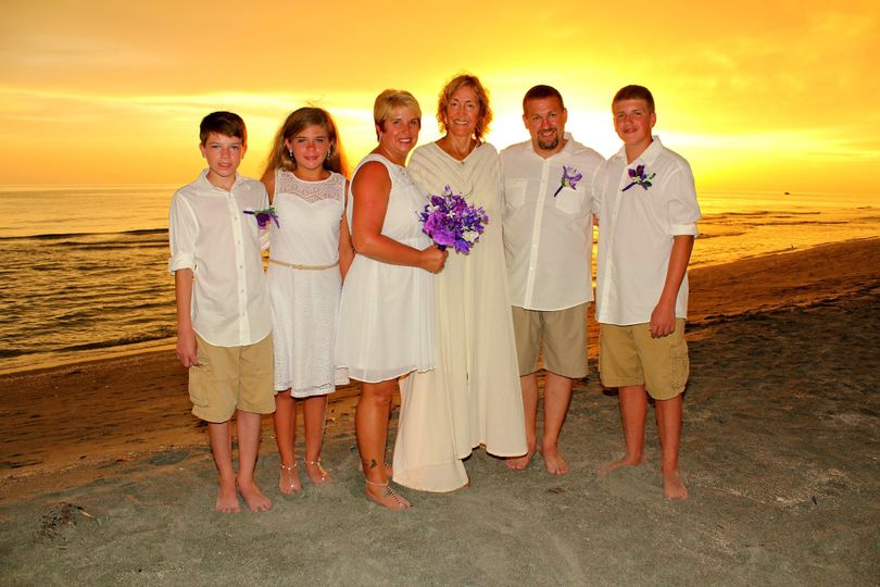 Officiant with the newlyweds' family