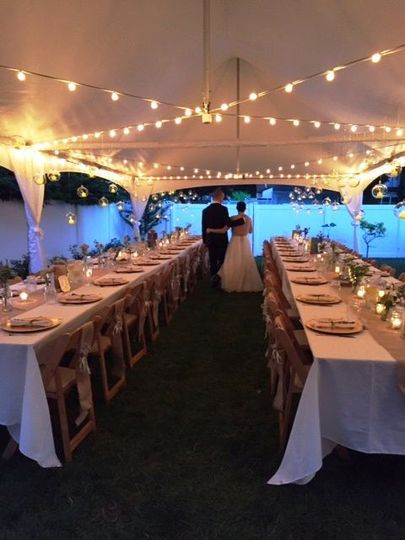 High Peak Frame Tent with Café Streamer Lighting.  Beautiful and intimate wedding.