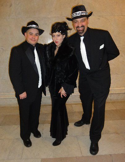 Diane Martinson Jazz Trio (vocal, piano drums), dressed for playing 1920's & 30's music at an...