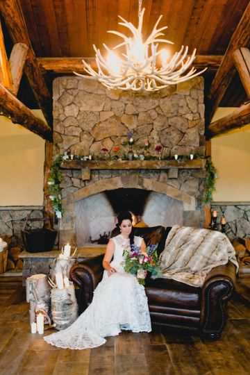 Beautiful fireplace and antler chandeliers