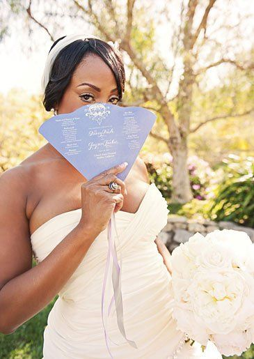 Actress Niecy Nash holding her wedding program done by Sugar River Stationers. Photo by Heidi Ryder...