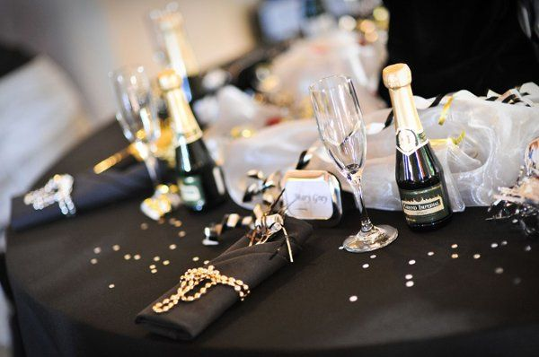 Banquet table setting for a black and white themed event.