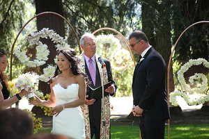 rohan bride handing bouquet