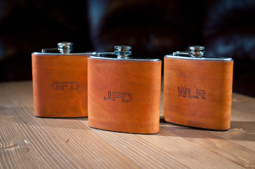 Custom leather wrapped flasks: hand dyed color is saddle tan hand sewn in the back