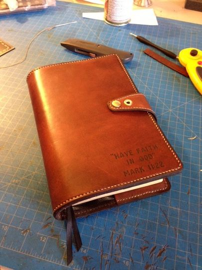 custom leather cover for the family's heirloom bible used in the wedding.