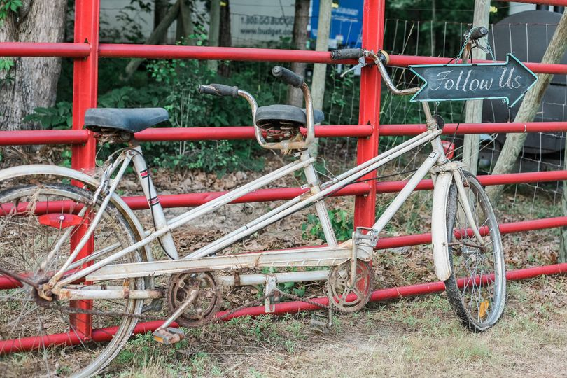 Tandem bicycle with sign