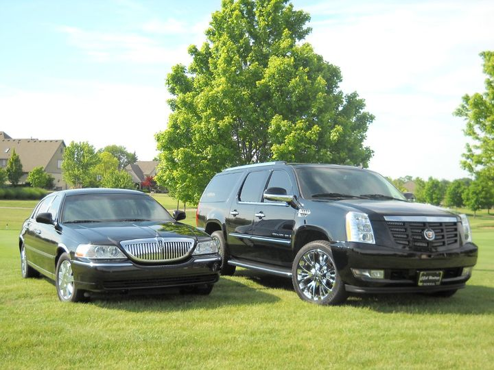 Lincoln Town Car Signature L Sedan & Cadillac Escalade ESV.