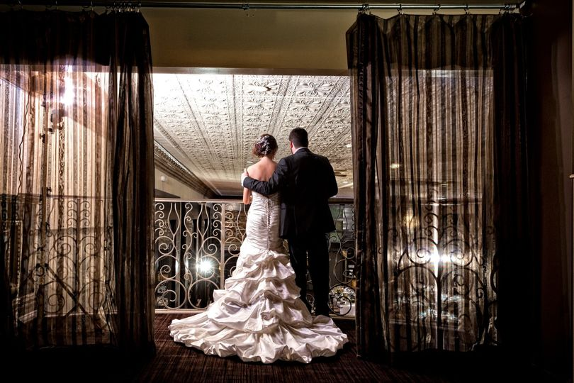 Couple Overlooking Ballroom