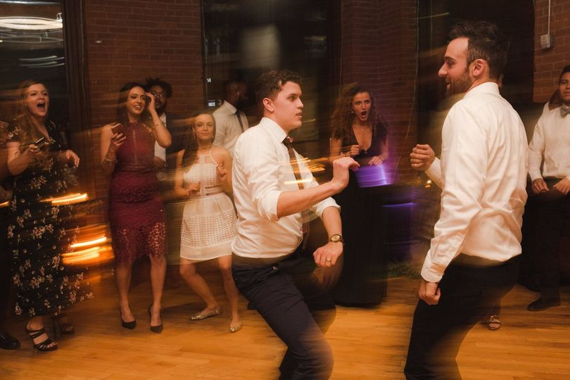 Groom and friend on the dance floor