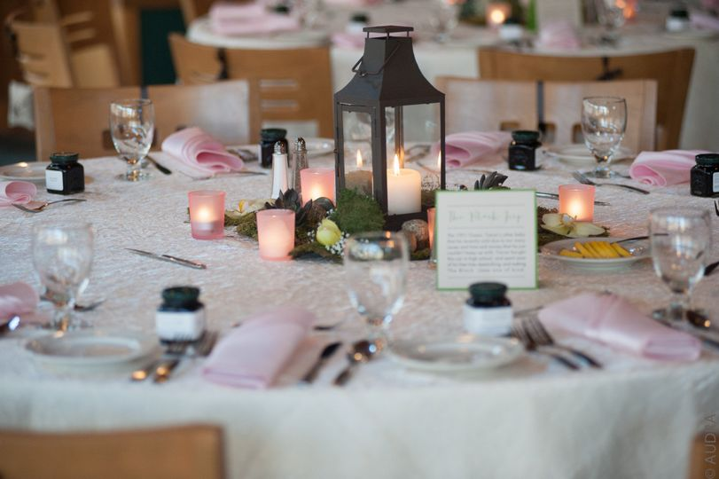Round table setup with a touch of pink