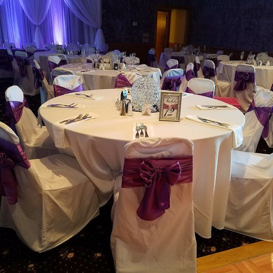 White chairs with purple bows