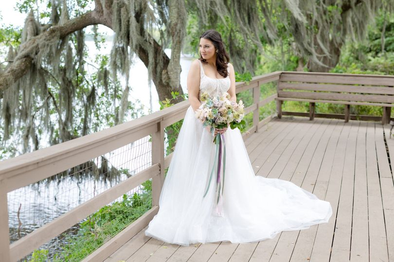 Bride looks to the water