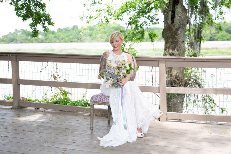 Bride sits on deck