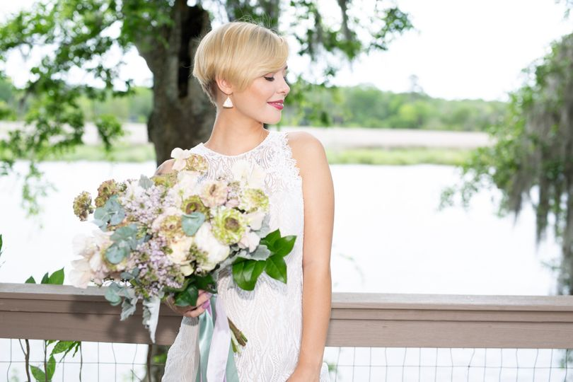 Bride poses with flowers