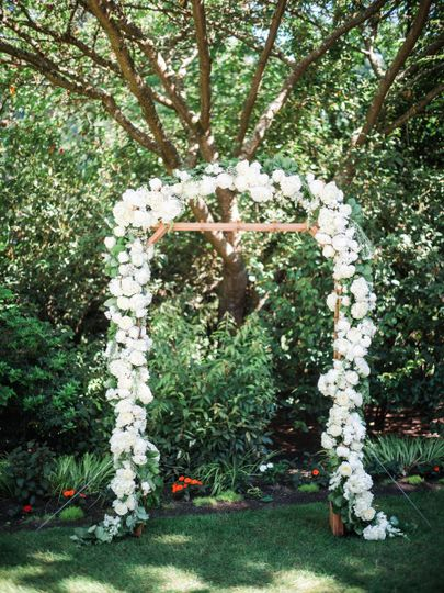 Wedding arch decorated in white flowers