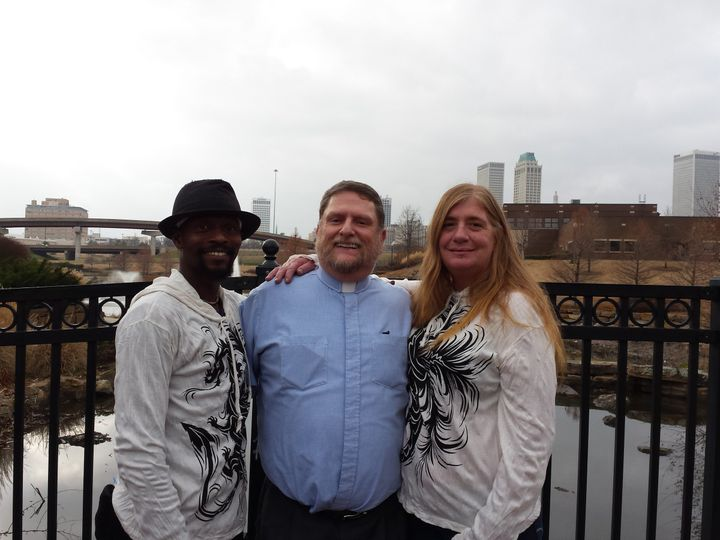 Donna and Rashid pose with Rev Bob after their wedding in Centennial Park in Tulsa, OK