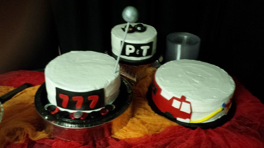 Their wedding cake related to their work as volunteer fire fighters.