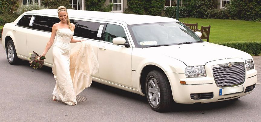 White Chrysler Stretch Limo 300 seats 10-12 passengers
