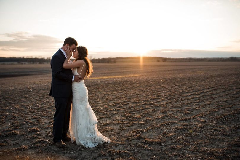 Newlyweds during sunset