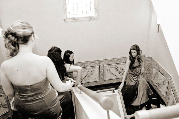 The bridesmaids head downstairs to the ceremony.