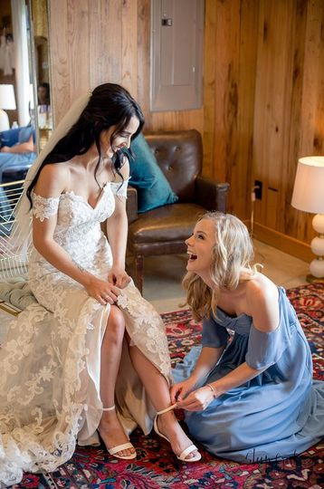 Assisting the bride with her heels