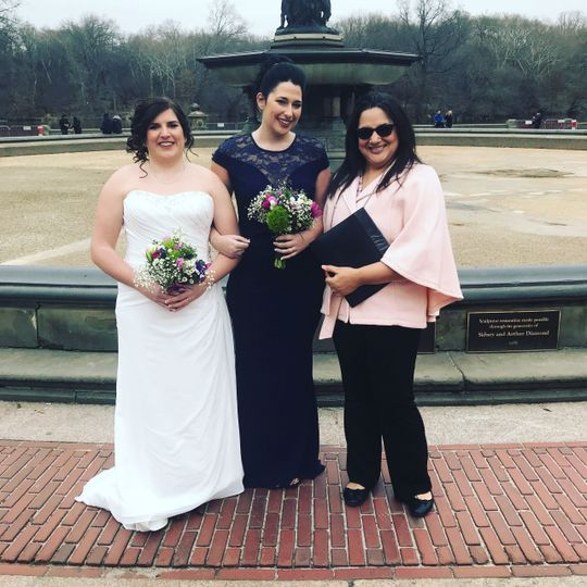 Officiant with the lovely brides