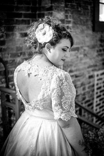 back view of a restyled vintage gown with pleated skirt and illusion lace sleeves.