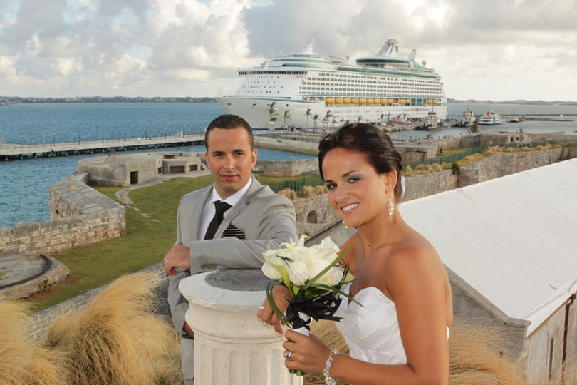 Newlyweds with cruise ship backdrop