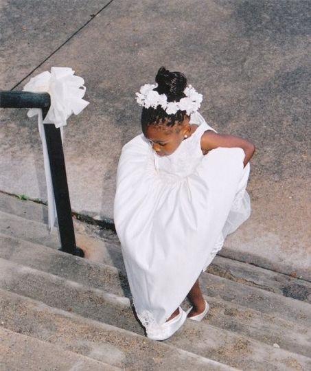Flower girl walking up steps