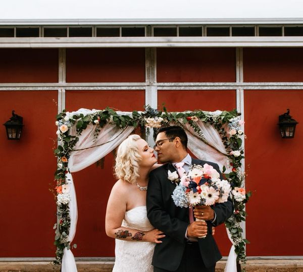 Newlyweds about to kiss