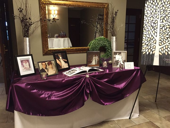 Guest log book table with violet linen