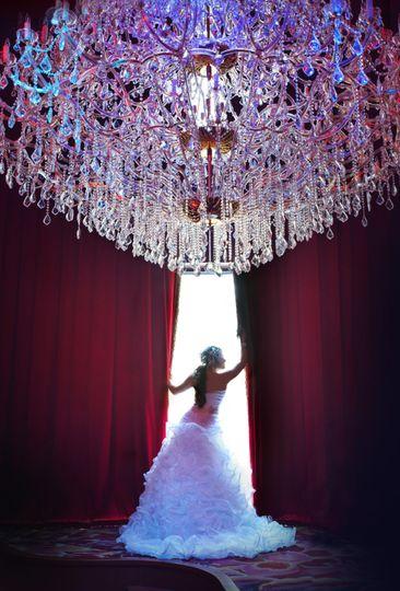 Bride beneath a beautiful chandelier