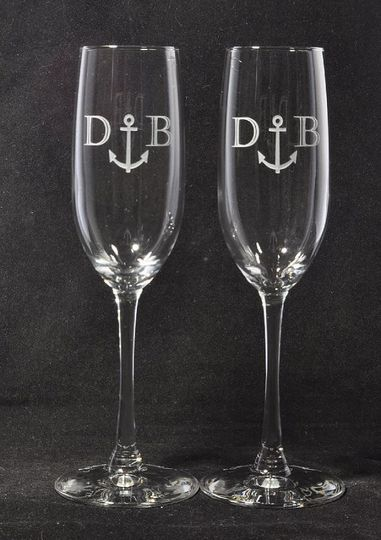 Monogrammed 8oz Champagne flutes.  Personalization (name and Date) on the bases of each glass.  $36