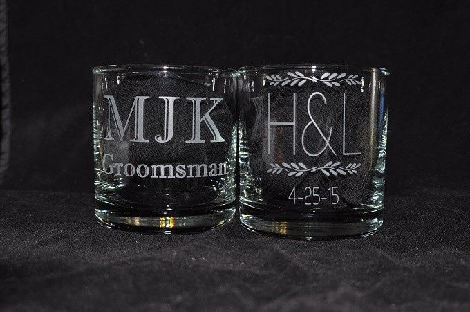 Personalized Rocks glasses with the Couple's Wedding logo on one side of the glass.  Initals and...