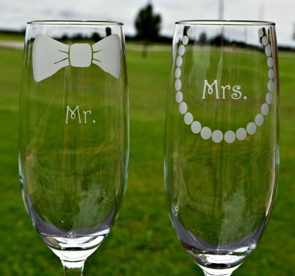 Mr. and Mrs. 8 oz Champagne Flutes.  Personalization (Name and Date) Sand Carved on the bases of...