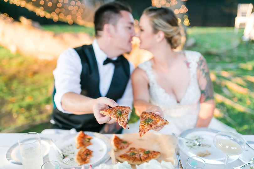 Newlyweds sharing pizza