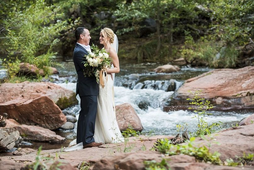 Newly weds at Serenity Point at L'Auberge de Sedona. Photos by Sedona Bride Photographers
