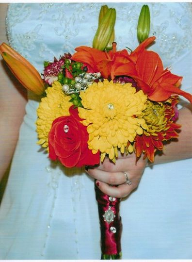 Bride's bouquet. I added brooches and pendants from the significant ladies in her life.