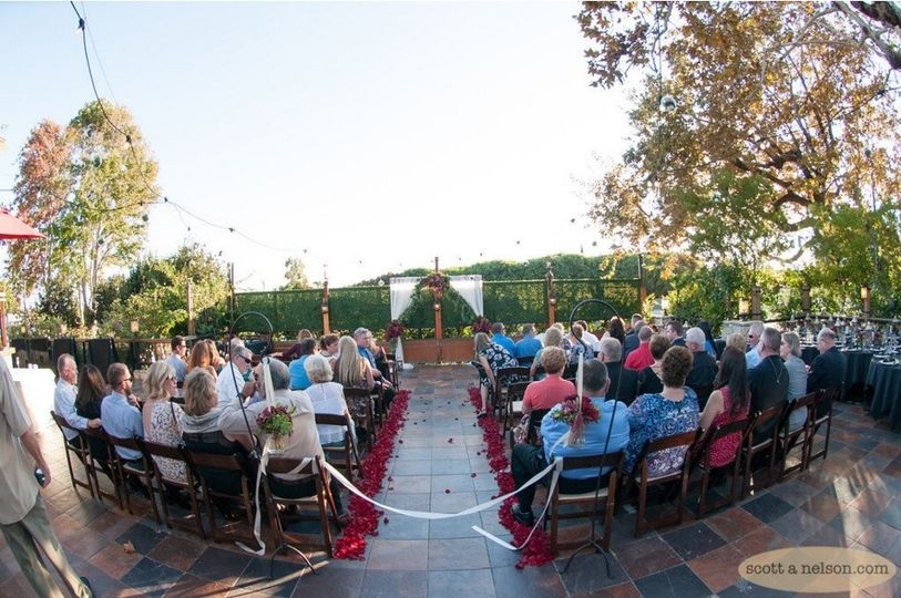 ceremony with reception tables on side