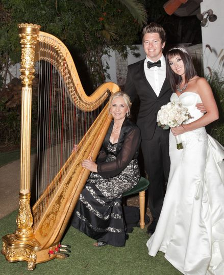 The newlyweds with the musician