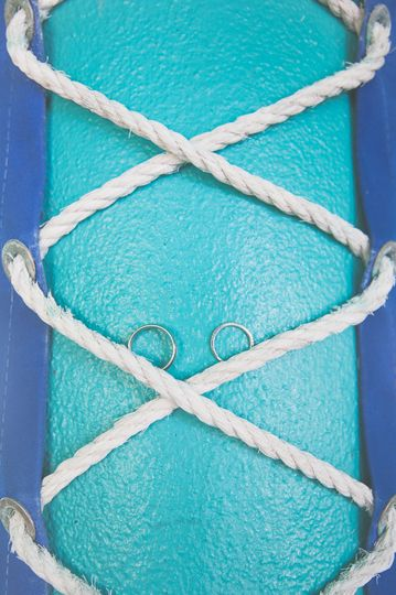 Wedding bands on ropes