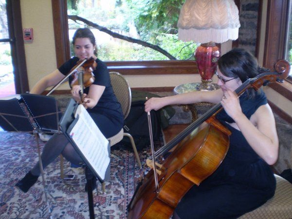 String Duo for Ceremony or Cocktail Hour. http://www.atmosphere-productions.com/livemusicians.html