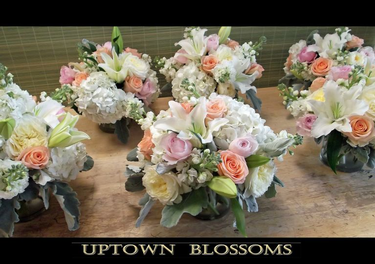 Centerpieces for reception using Hydrangea, Garden Roses, Lilies, Stock and other accent flowers in...