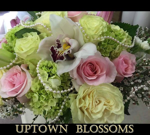 A Bridal Bouquet with Baby Green Hydrangea, soft pink and light green premium Roses, and strands of...