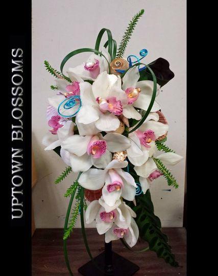 Cascade style bouquet of Cymbidium Orchids.